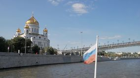Russian flag on boat in front of Christ the Saviour Cathedral stock video