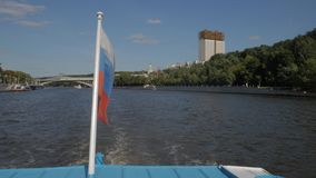 Russian flag on boat. Moving along Moskva river embankment and Sparrow Hills park in Moscow, Russia stock footage