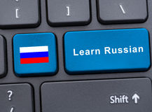 Russian flag button on the keyboard. And learn russian key as virtual learning concept stock images