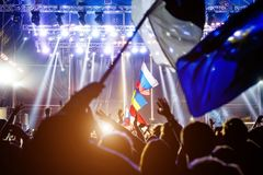 Russian flag at the concert, opposite the light from the stage. Russian flag at the concert, opposite the light from the stage Stock Photos