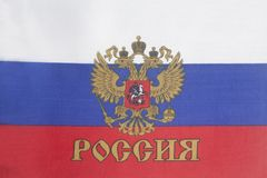 Russian flag with emblem of Russia. Background close up Stock Images