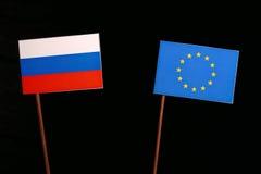 Russian flag with European Union EU flag  on black Royalty Free Stock Photos