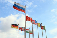 Russian flag and flags of other nations. Russian flag above the flags of other countries royalty free stock image