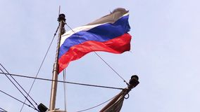 Russian flag is fluttering on a ship in windy day. Russian flag is fluttering on a ship in windy cloud day stock video