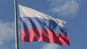 Russian flag. Flutters in the wind on the flagpole on blue sky background stock video