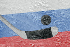 Russian flag and hockey puck with a stick Royalty Free Stock Images