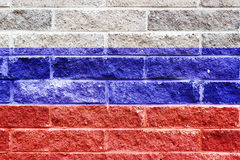 Russian flag painted on a gray stone bricks wall Stock Photography