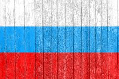 The Russian flag painted on a wooden fence. Political concept. Old texture. Stock Images