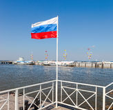 Russian flag at the Peterhof harbor in summer sunny day Stock Photography