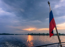 Russian flag on ship as it leaves St. Persburg Stock Images