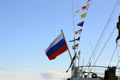Russian flag on the stern of the ship Stock Photos
