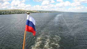 Russian flag on the stern of the ship, Volga river, Saratov, Russia stock footage