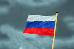 Russian flag on storm-clouds background Stock Photo