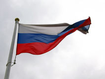 Russian flag tricolor waves under the wind. Stock Photo