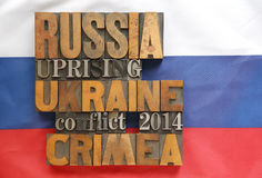Russian flag with Ukraine, Russia and Crimea words Stock Image