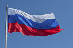 Russian flag. Waving against a blue sky Russian flag Stock Image