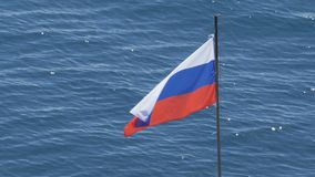 Russian flag waving in the background of the glare on the water. stock footage