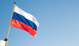 Russian flag waving on wind. Symbol of patriotism Royalty Free Stock Photography