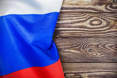 Russian flag on a wooden table Royalty Free Stock Photos