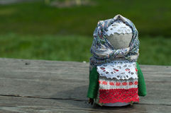 Russian folk doll. Russian traditional rag doll on nature background Royalty Free Stock Photo