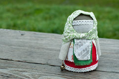 Russian folk doll. Russian traditional rag doll on nature background Royalty Free Stock Photos