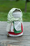 Russian folk doll. Russian traditional rag doll on nature background Royalty Free Stock Images