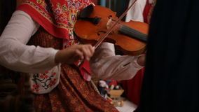 Russian folk group musician - woman play violin, slow-motion stock footage