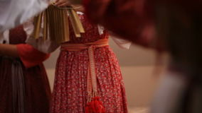 Russian folk musical group - woman in traditional costumes plays musical instruments - ratchet, slow-motion stock footage