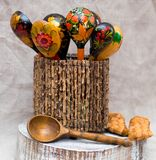Russian folk painted wooden spoons in a vase royalty free stock photography