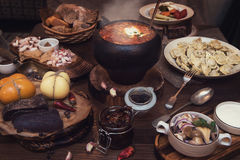 Russian food table. Russian food: borsch pickles cheese meat dumplings and fat royalty free stock photography