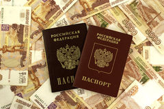 Russian foreign and domestic passport on a background of money stock photo