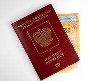 Russian foreign passport and money stock photo