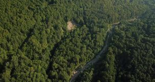 Russian Forest And Mountains Under Blue Sky By Aerial Drone. Stunning Aerial Drone Stock Footage of South russian Forest And Mountains Under Blue Sky stock video footage