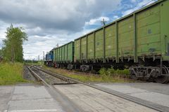 Russian freight train in motion Royalty Free Stock Image