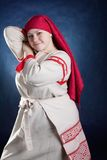 Russian funny woman posing in national clothes Royalty Free Stock Photo