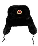 Russian Fur Hat. Black Russian fur hat, with hammer and sickle medallion.  Isolated on white Stock Photo