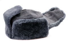 Russian fur hat with ear-flaps isolated. On white Stock Image