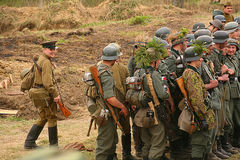 Russian and German soldiers. the reconstruction of the battle in military uniform of world war II. Royalty Free Stock Photography