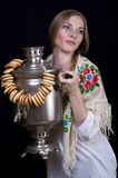 Russian girl. Drinking tea with samovar Stock Image