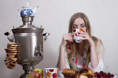 Russian girl. Drinking tea with samovar Royalty Free Stock Photography