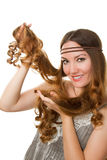 Russian girl advertises long curly hair Royalty Free Stock Images
