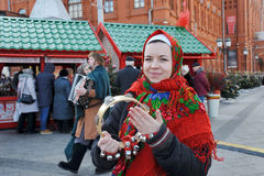 Russian Girl with Bells Celebrating Maslenitsa stock photo