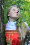 Russian girl birch. Girl in the Russian national costume is the birch Stock Images