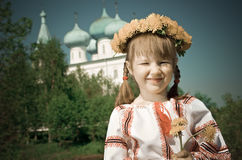 Russian girl on church. Russian little girl on a orthodox church background royalty free stock images