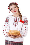 Russian girl with crepes in folk costume Stock Photography