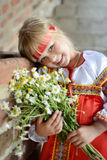 Russian girl with flowers Stock Photo