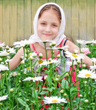 Russian girl in a headscarf Stock Images