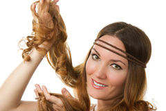 Russian girl-hippie advertises long curly hair Royalty Free Stock Photography