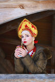 Russian girl in a kokoshnik. Russian girl drinking tea in a kokoshnik stock images