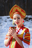 Russian girl in a kokoshnik. Russian girl drinking tea in a kokoshnik Royalty Free Stock Images